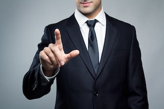 Joven, ejecutivo, hombre, tocar, imaginario, pantalla