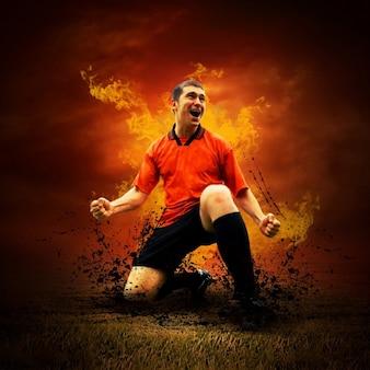 Jugador de fútbol feliz en llamas