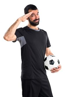 Jugador de fútbol saludando