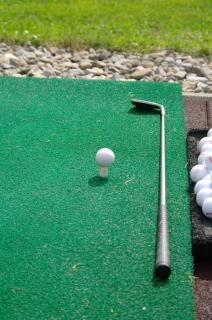 la práctica del golf, el juego