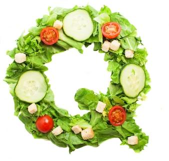 Letra q hecha con diferentes verduras