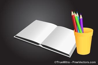 Libro blanco con lápices de colores