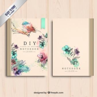 Mano cubierta del cuaderno pintado