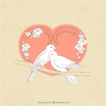 Mano dibujado par de pájaros