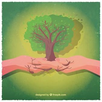 Manos con un árbol