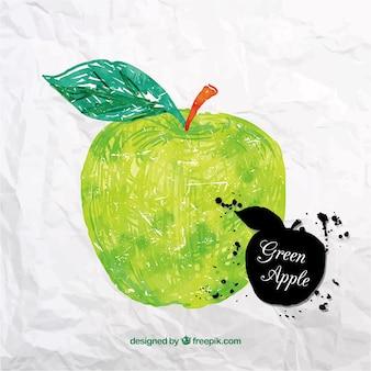 Manzana dibujada a mano en papel arrugado