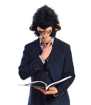 Mono, hombre, lectura, libro