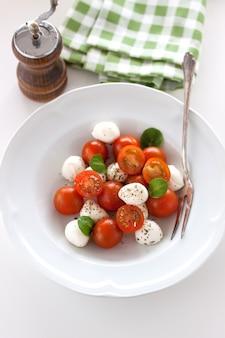 Mozarella con tomates