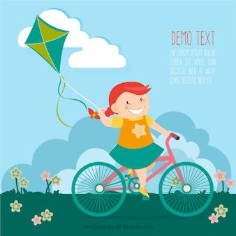 Muchacha en la bicicleta con una cometa