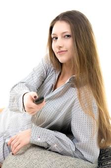 Mujer con un mando a distancia