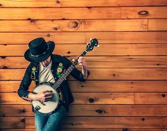 Músico de banjo de juego