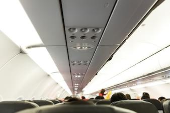 No fumar y uso del cinturón de asiento de la muestra en el avión