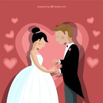 Novio que pone el anillo en el dedo de la novia