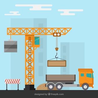 Obras de construcción con una grúa y un camión