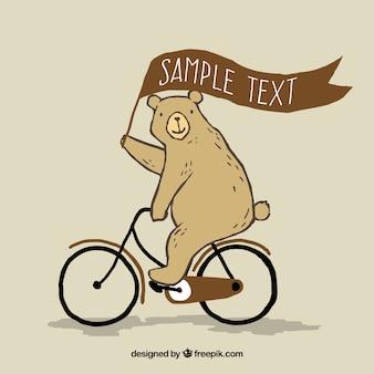 Oso dibujado a mano montando en bici