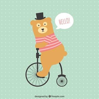 Oso divertido montando en bicicleta