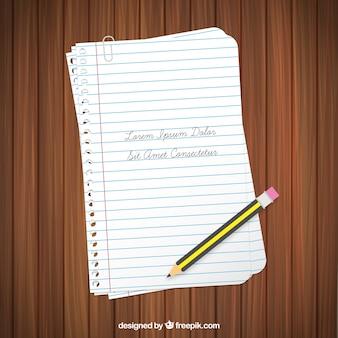 Páginas del cuaderno y el lápiz