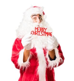 Papa noel con unas letras que dicen  merry christmas