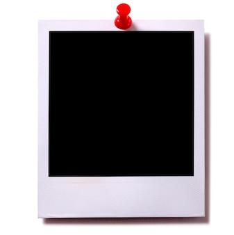 Papel fotográfico con una chincheta