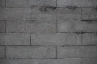 Pared hecha de ladrillos grises