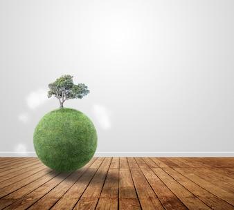 Pequeño planeta con un árbol sobre madera