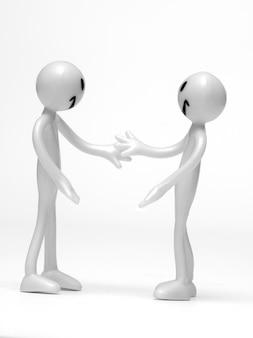 Personajes blancos cerrando un acuerdo