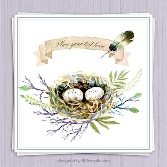 Pintado a mano nido en una rama