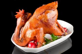 Pollo entero cocinado