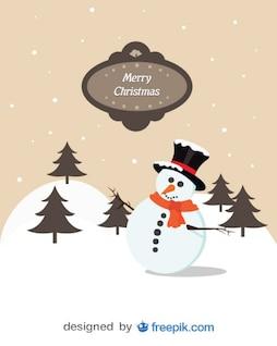 Postal de Feliz Navidad de un muñeco de nieve en el bosque