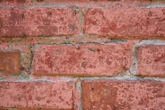 Primer plano de pared de ladrillo rojo