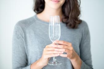 Primer plano, mujer, tenencia, champaña, flauta