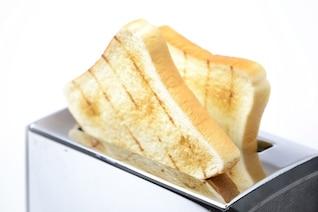 rebanada de pan tostado surge la tostadora alimentos