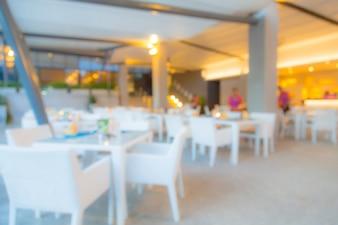Restaurante borroso con muebles blancos