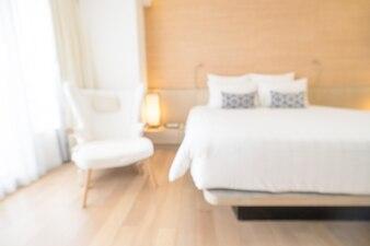 Sillón y cama de matrimonio borrosa