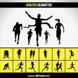 Siluetas de corredores en la carrera
