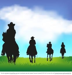 Siluetas de vaquero occidentales sobre la hierba