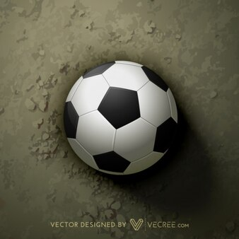 Balón de fútbol en fondo de la arena