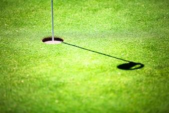 Sombra de la bandera de un agujero de campo de gol