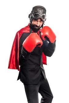 Super héroe hombre de negocios con guantes de boxeo