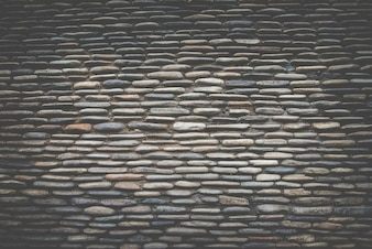 Superficie real de la pared de piedra, filtro retro oscuro