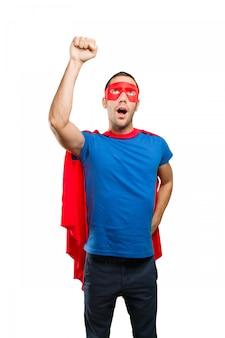 Superhéroe sorprendido con un gesto de la mosca