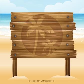 Tabla de madera en la playa