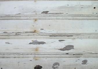 Tablas de madera con pintura estropeada
