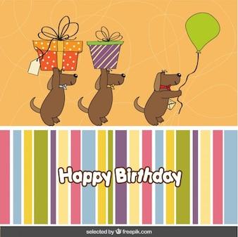 Tarjeta de cumpleaños con tres perros encantadores