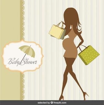 Tarjeta de la bienvenida del bebé con la silueta embarazada