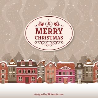 Tarjeta de la Feliz Navidad con paisaje urbano
