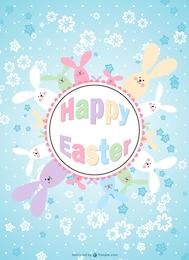 Tarjeta de Pascua con conejitos y flores