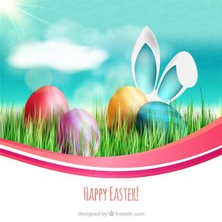 Tarjeta de Pascua con huevos de colores y orejas de conejo