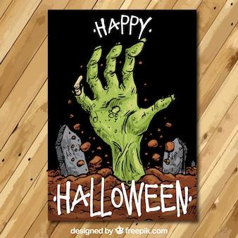 Tarjeta del feliz Halloween con una mano de zombi dibujada a mano
