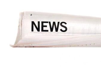 Titulares de noticias papel enrollado
